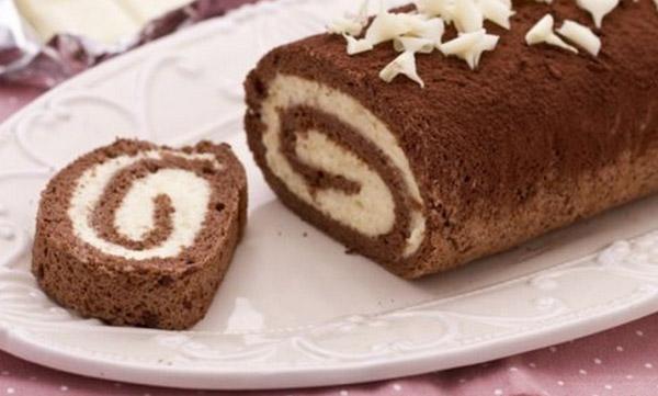 Dolcezza in cucina: il contrasto nella cucina Karisma di Gicinque abbinato alla dolcezza del rotolo al cacao con crema al cioccolato bianco