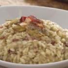 Un risotto raffinato e saporito per una cucina estremamente elegante come Oyster di Gicinque, nella versione in finitura olmo